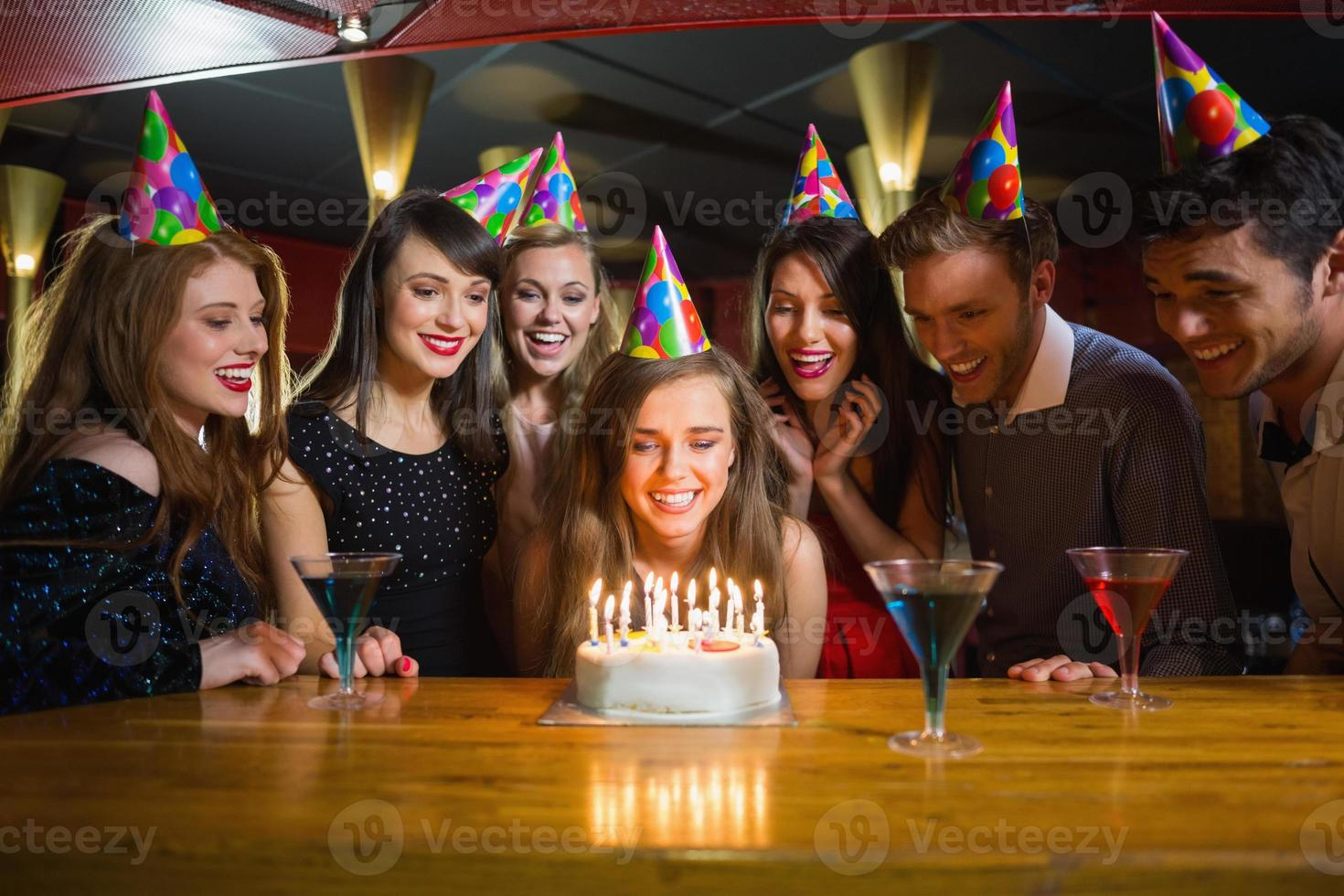 Friends celebrating a birthday together photo