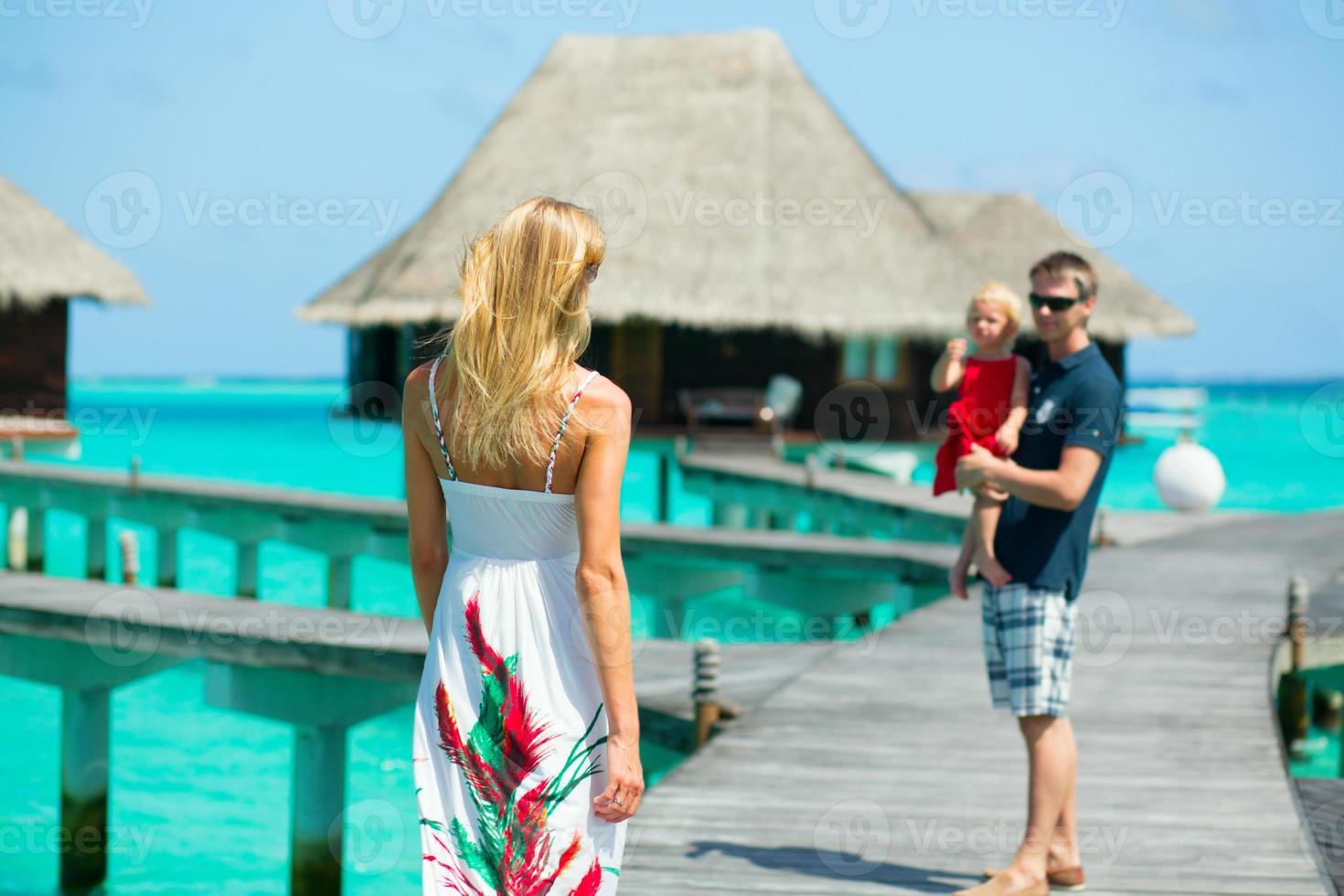 Family having tropical vacation photo