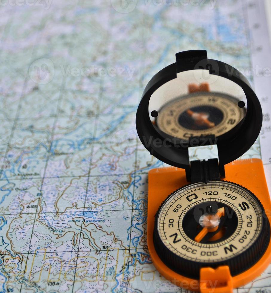 Equipment for travel - map and compass. photo