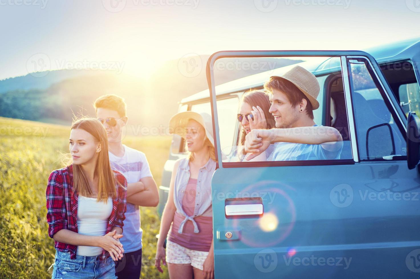 Young hipster friends on road trip photo