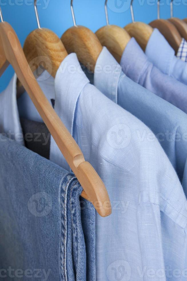 Mens Blue Shirts And Jeans On Hangers photo