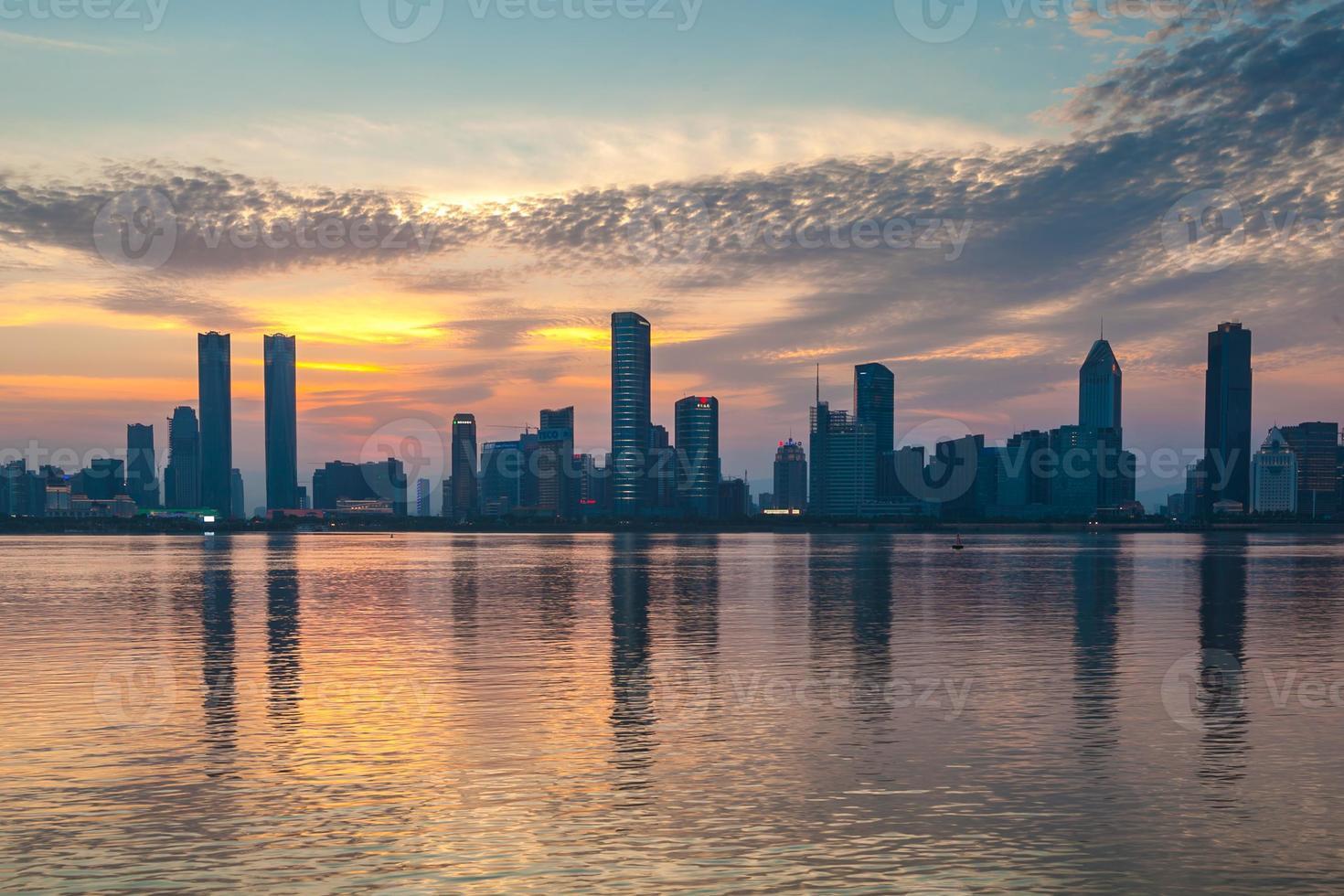 Sunset illuminated city photo