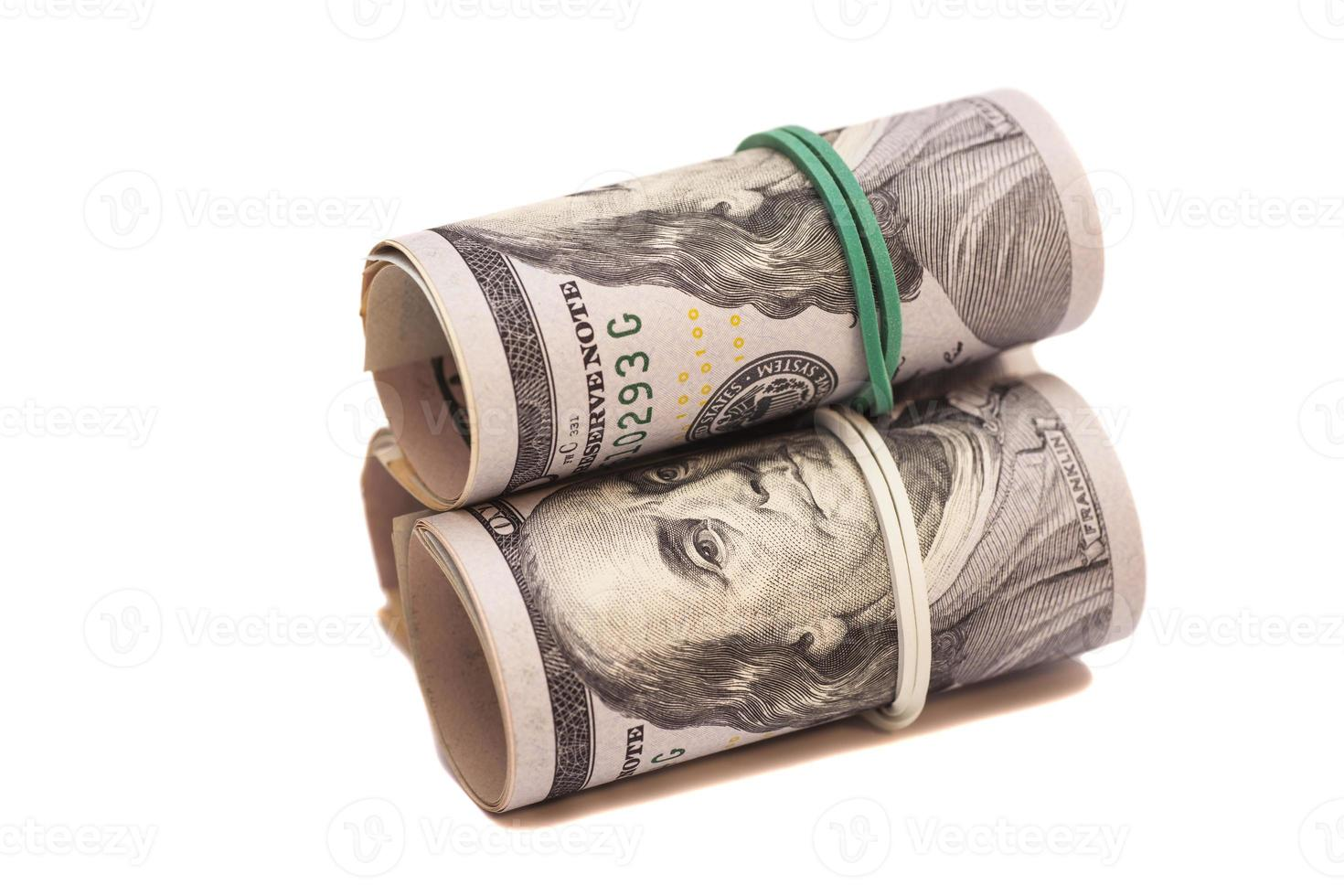 Dollar banknotes roll isolated on white background photo