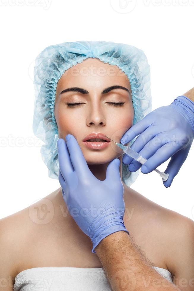 Cosmetic botox injection to the pretty woman face photo
