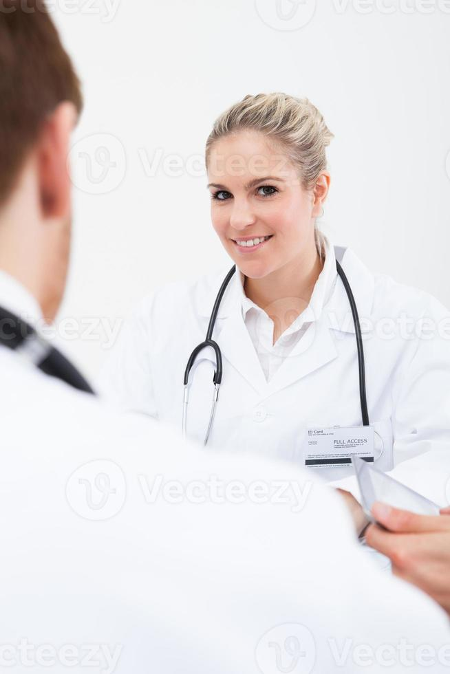 Doctor Looking At Colleague In Meeting photo