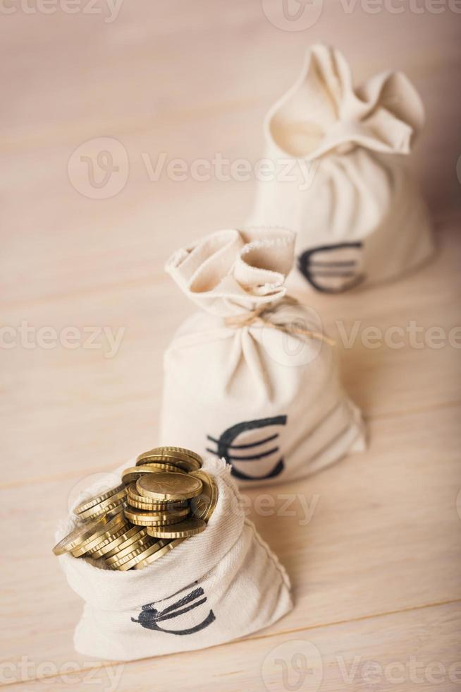 Money bags with euro coins, selected focus photo