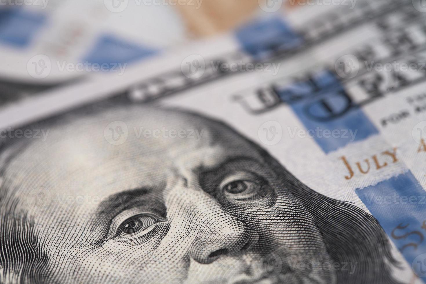 Close-up of an image of Benjamin Franklin on a dollar bill photo