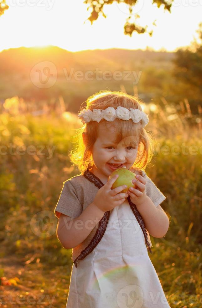 Girl biting an apple photo