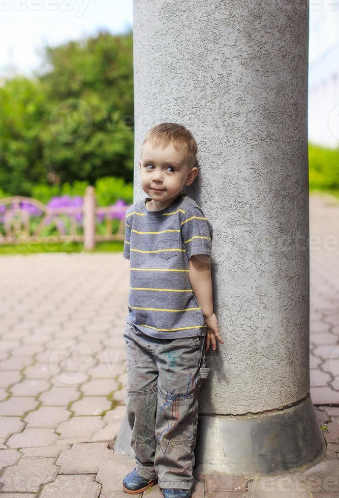 boy playing hide and seek photo