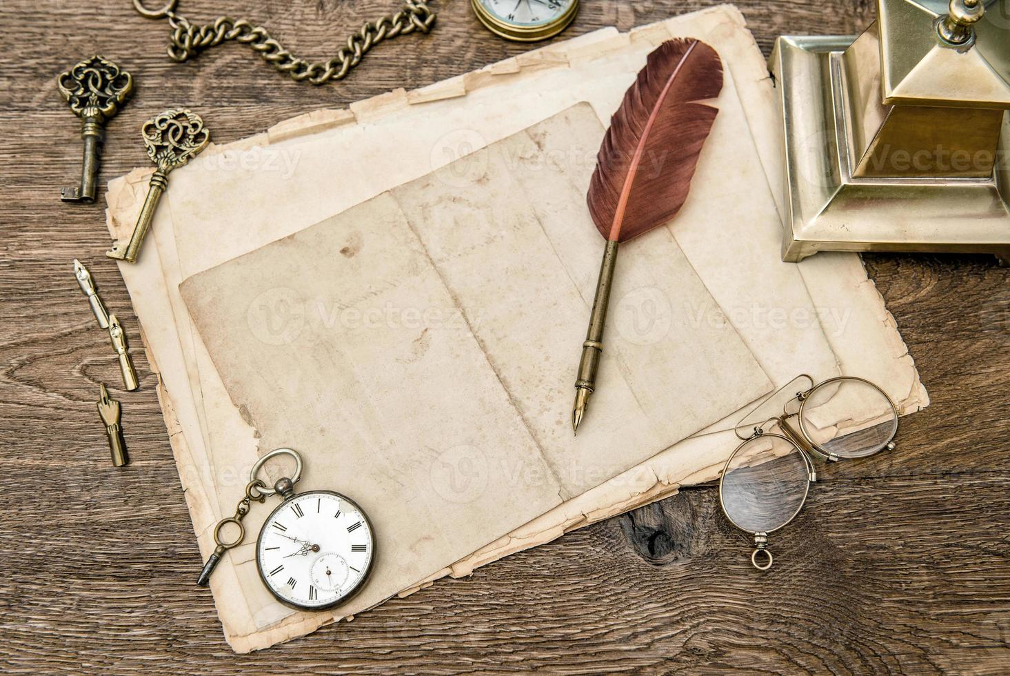 Antique office supplies and accessories, used paper, feather pen photo