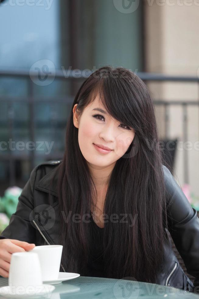 Pretty young woman drink coffee photo