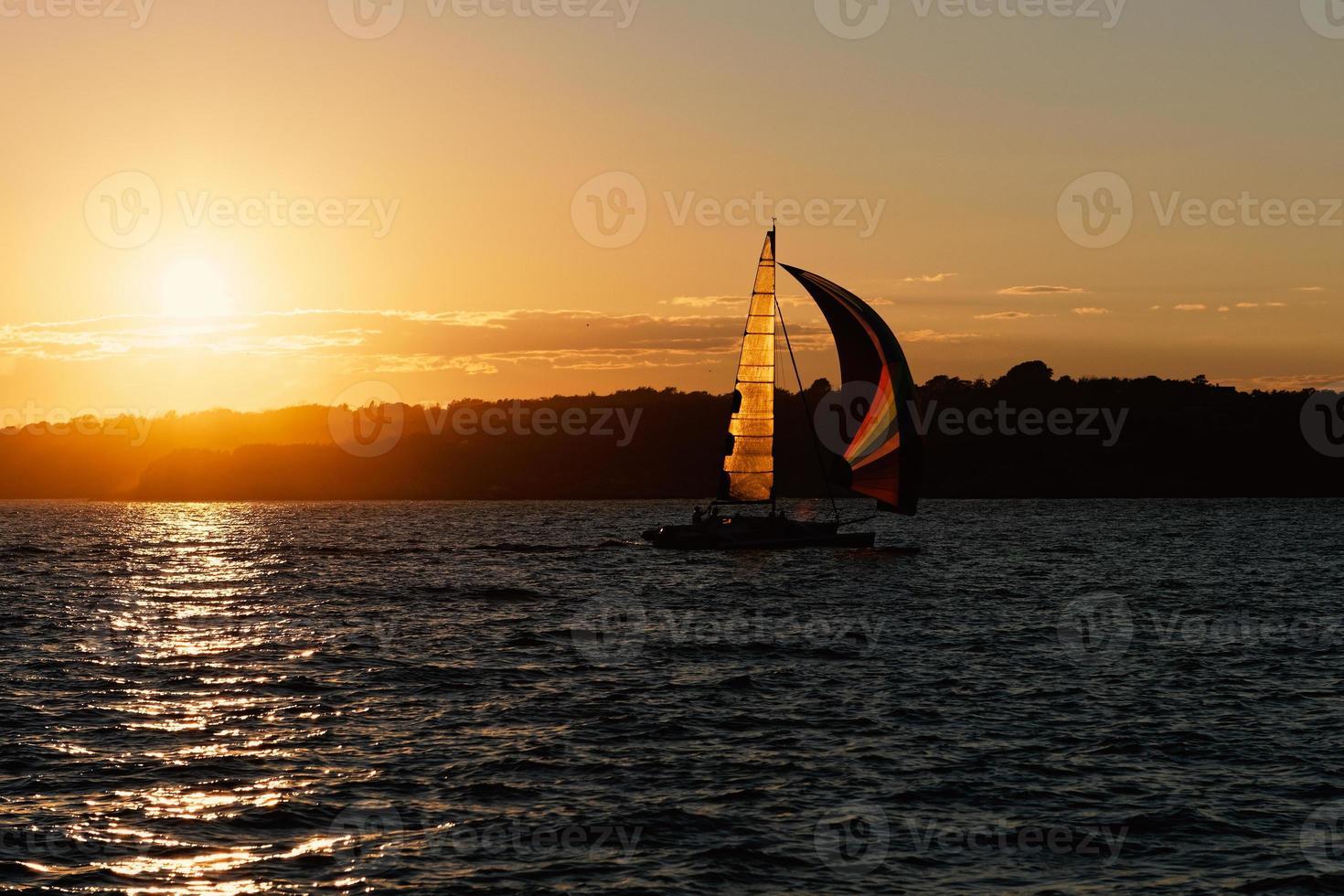 Sail ship at the sunset. photo