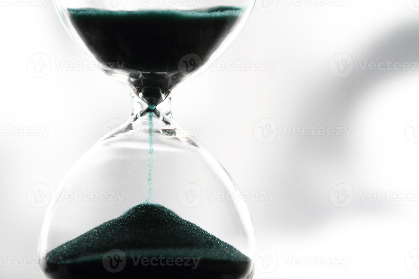 primer plano de reloj de arena foto