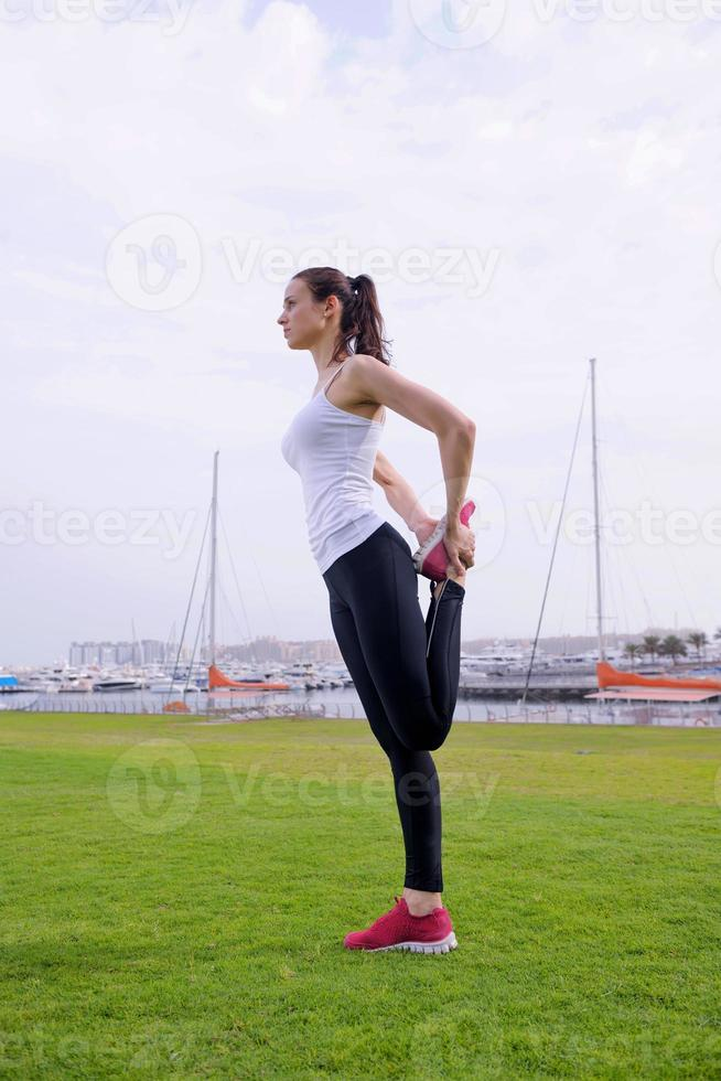 Young beautiful  woman jogging  on morning photo