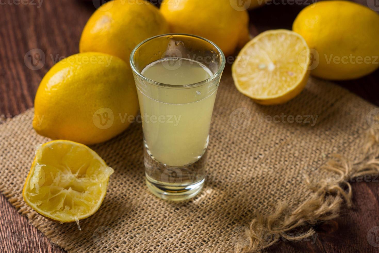 Fresh lemons on the wooden table photo
