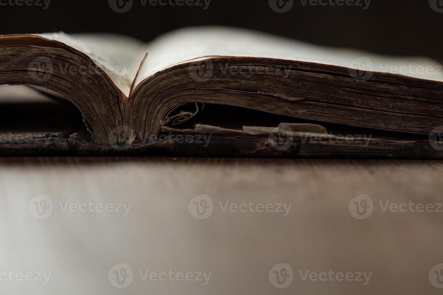 Image of an old Holy Bible on wooden background photo