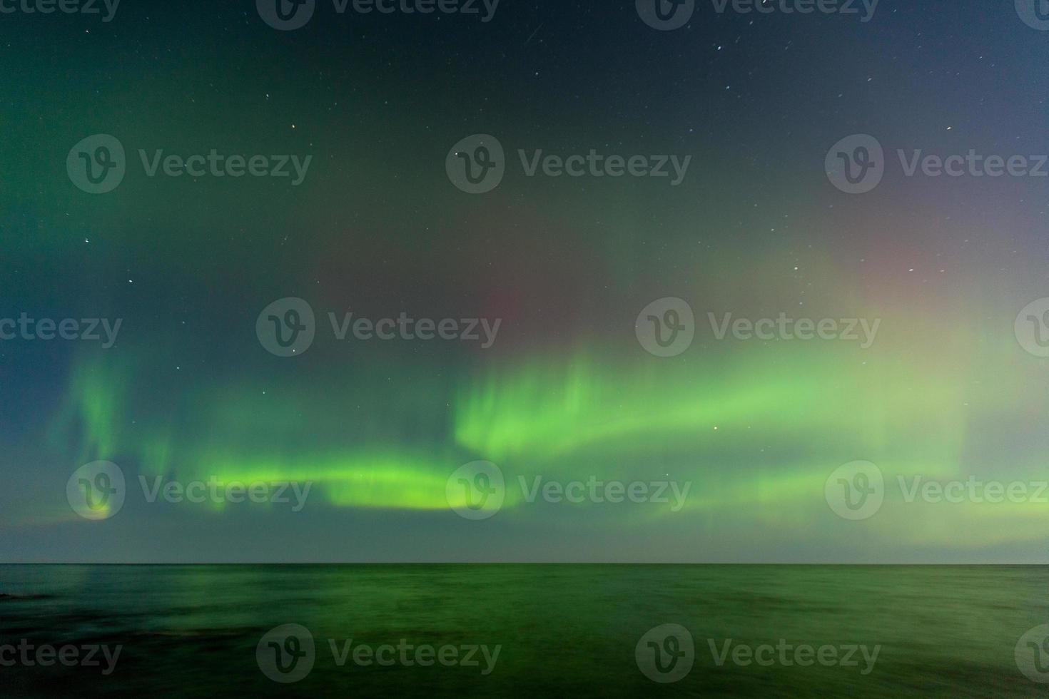 Aurora Borealis over Lake Superior in Michigan photo