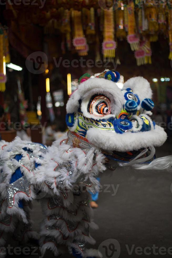 Dragon performers, Saan Jao Joe Sue Gong temple, Bangkok, Thailand. photo