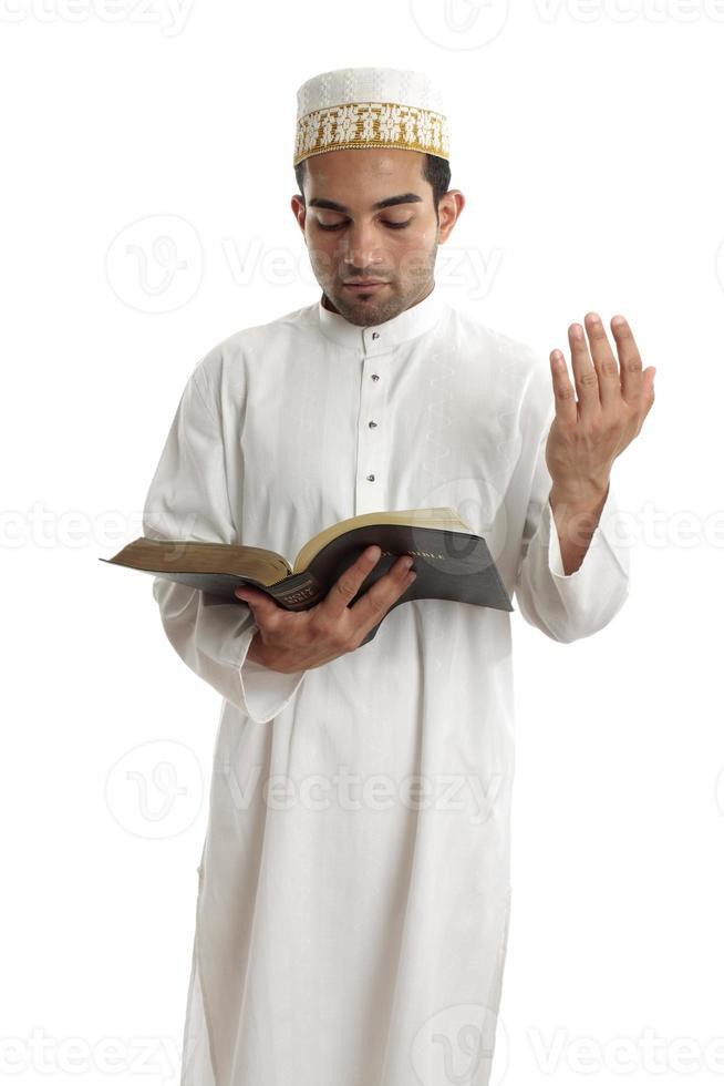 Teacher or Preacher reading from a book photo