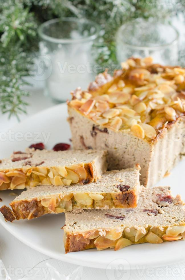 Poultry turkey pate with cranberries and almonds photo