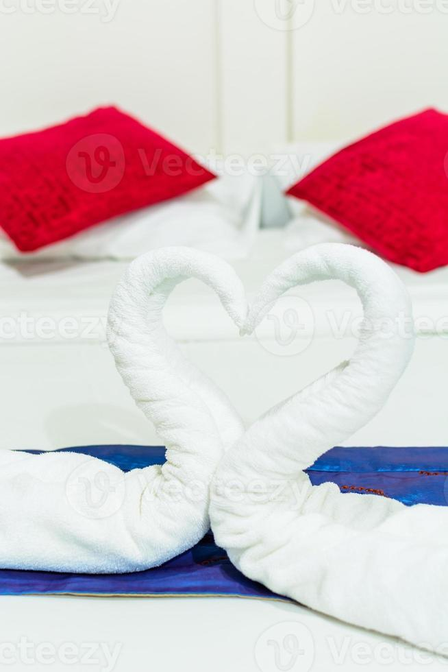towel swans shaped on the bed photo