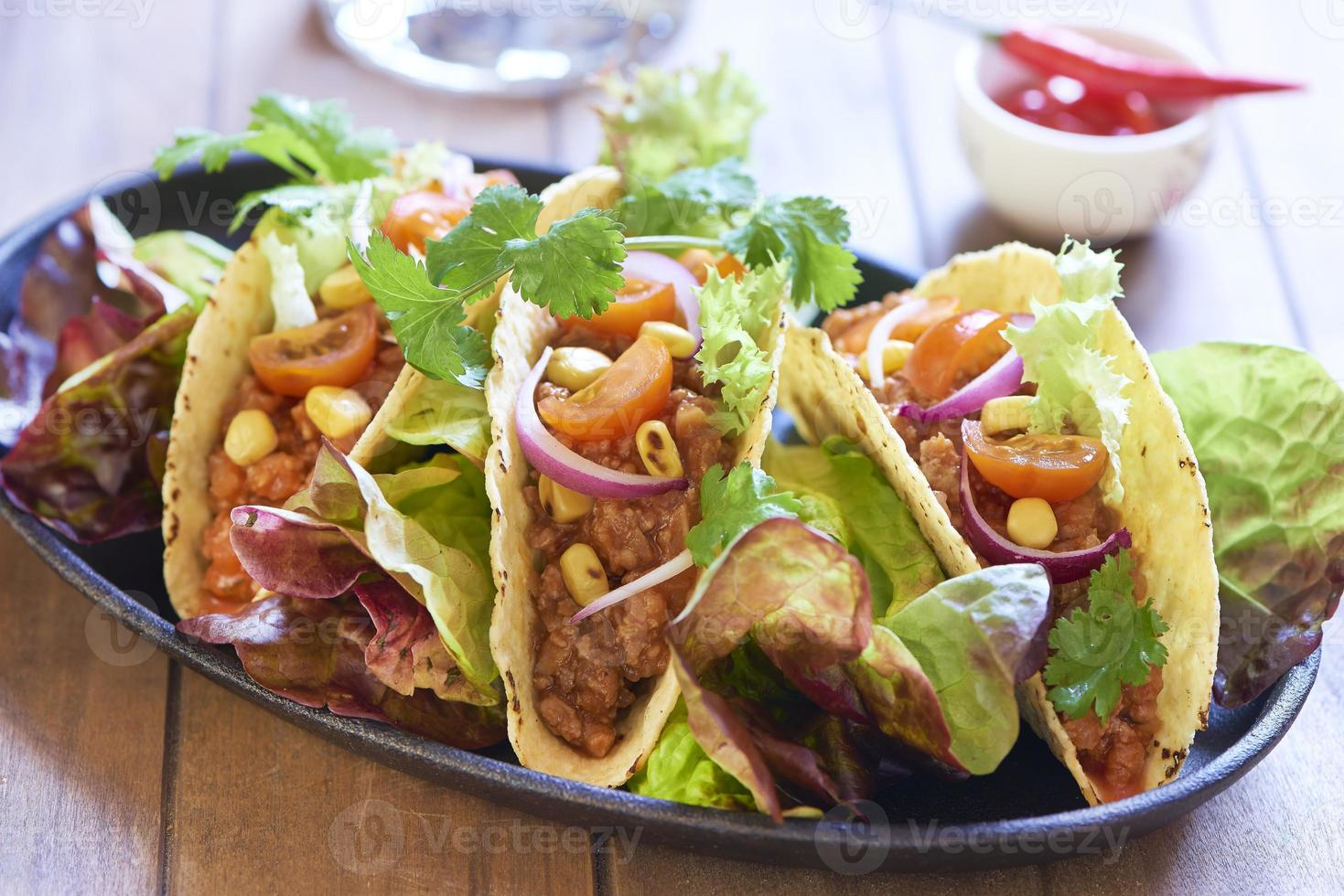 Plate with taco, salad and tomato dip photo