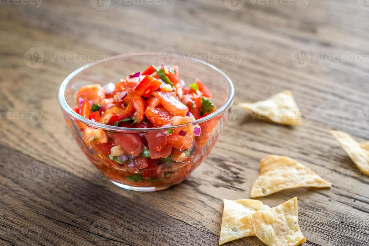 Bowl of salsa with tortilla chips photo