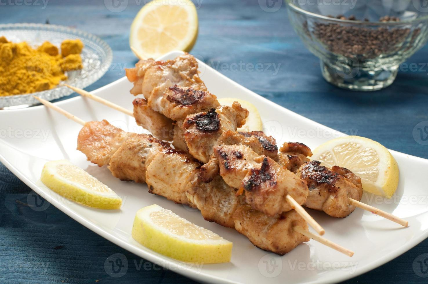 Indonesian chicken satay skewers with curry photo