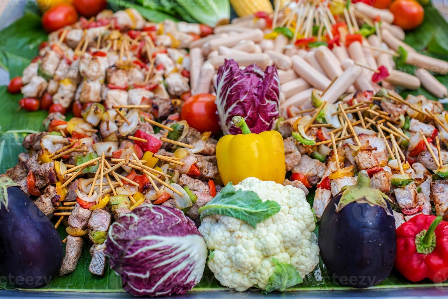 kebab with vegetables and sausages photo