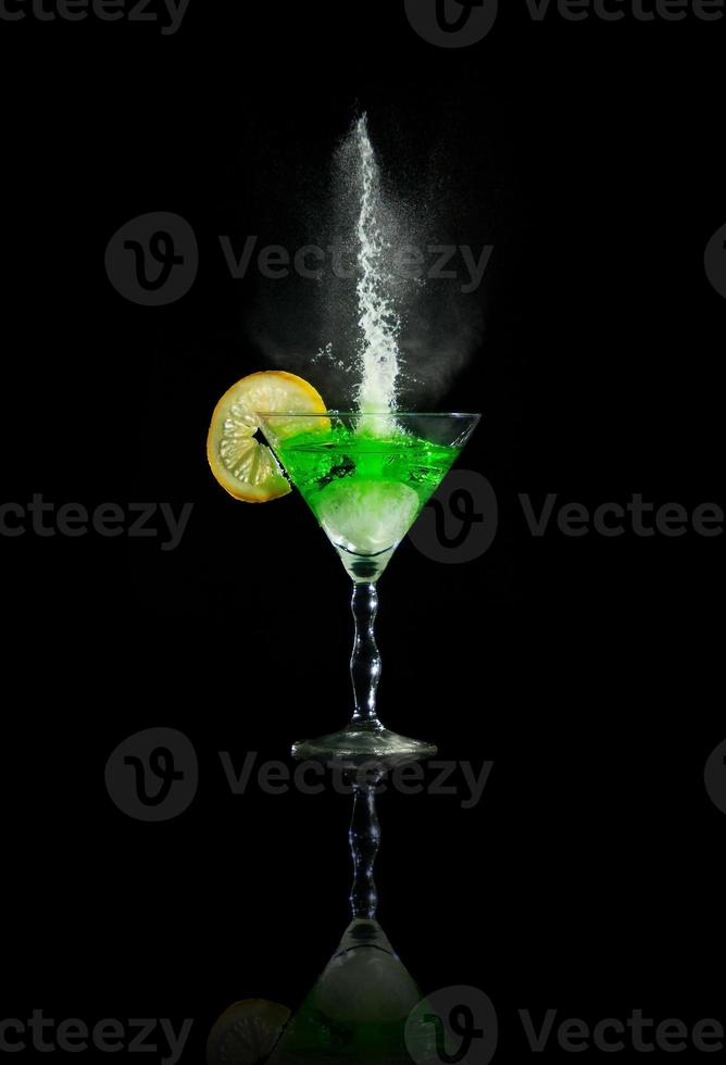 Glass of martini with lime and splashes photo