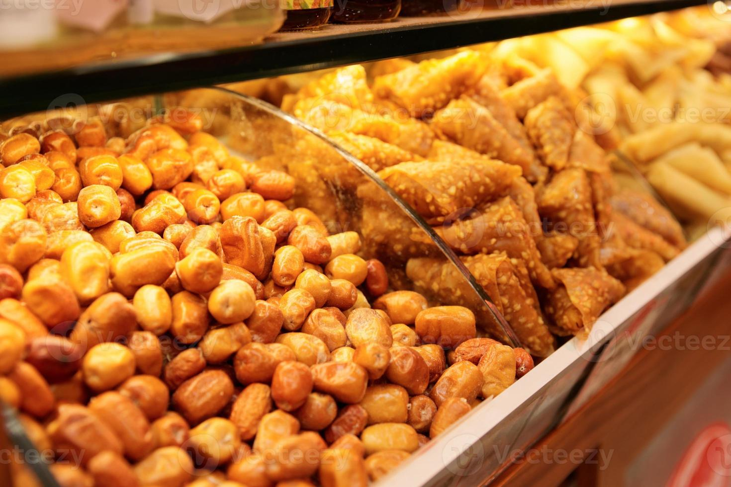 Nuts and baklava on market shelf photo