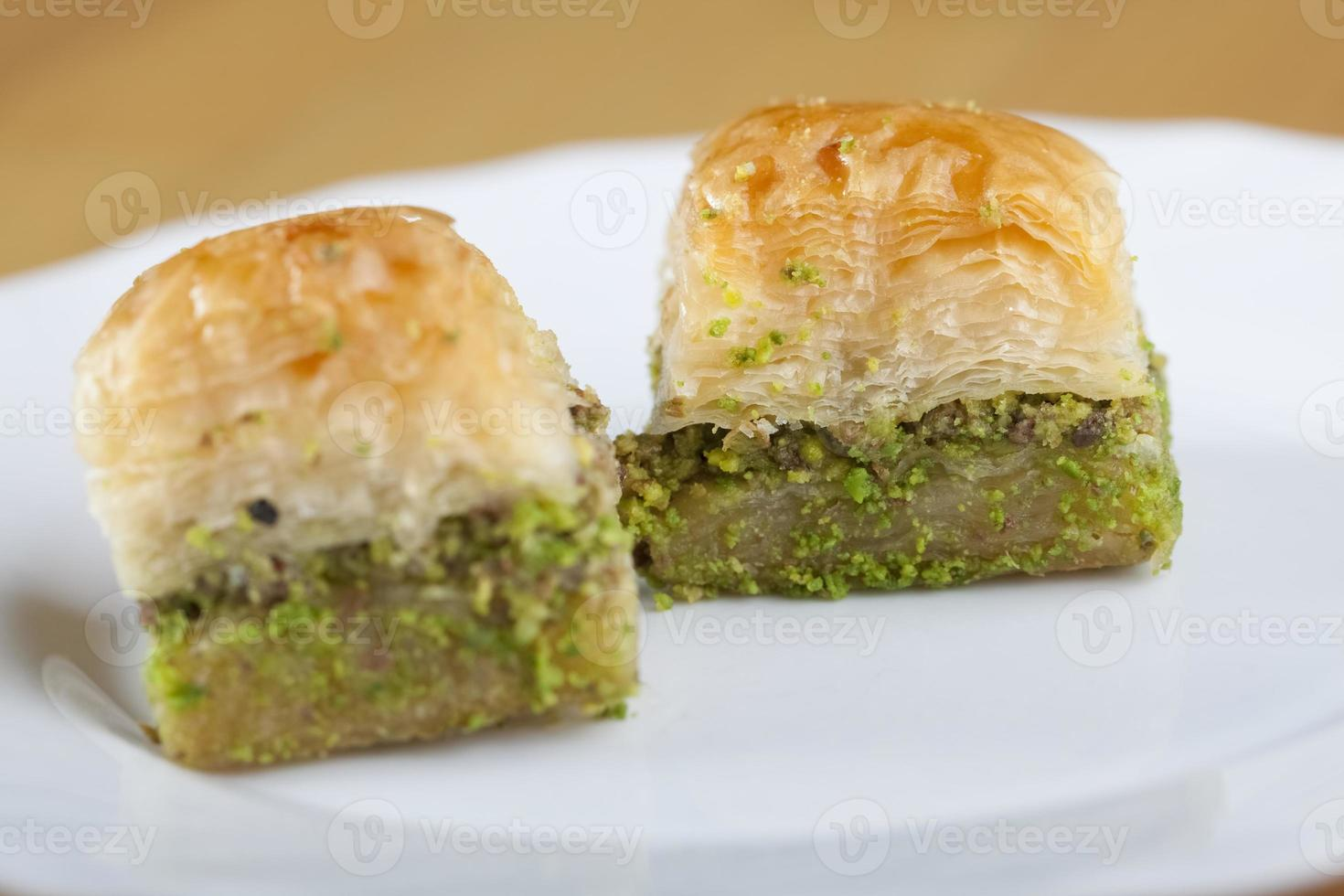Two baklava in plate photo