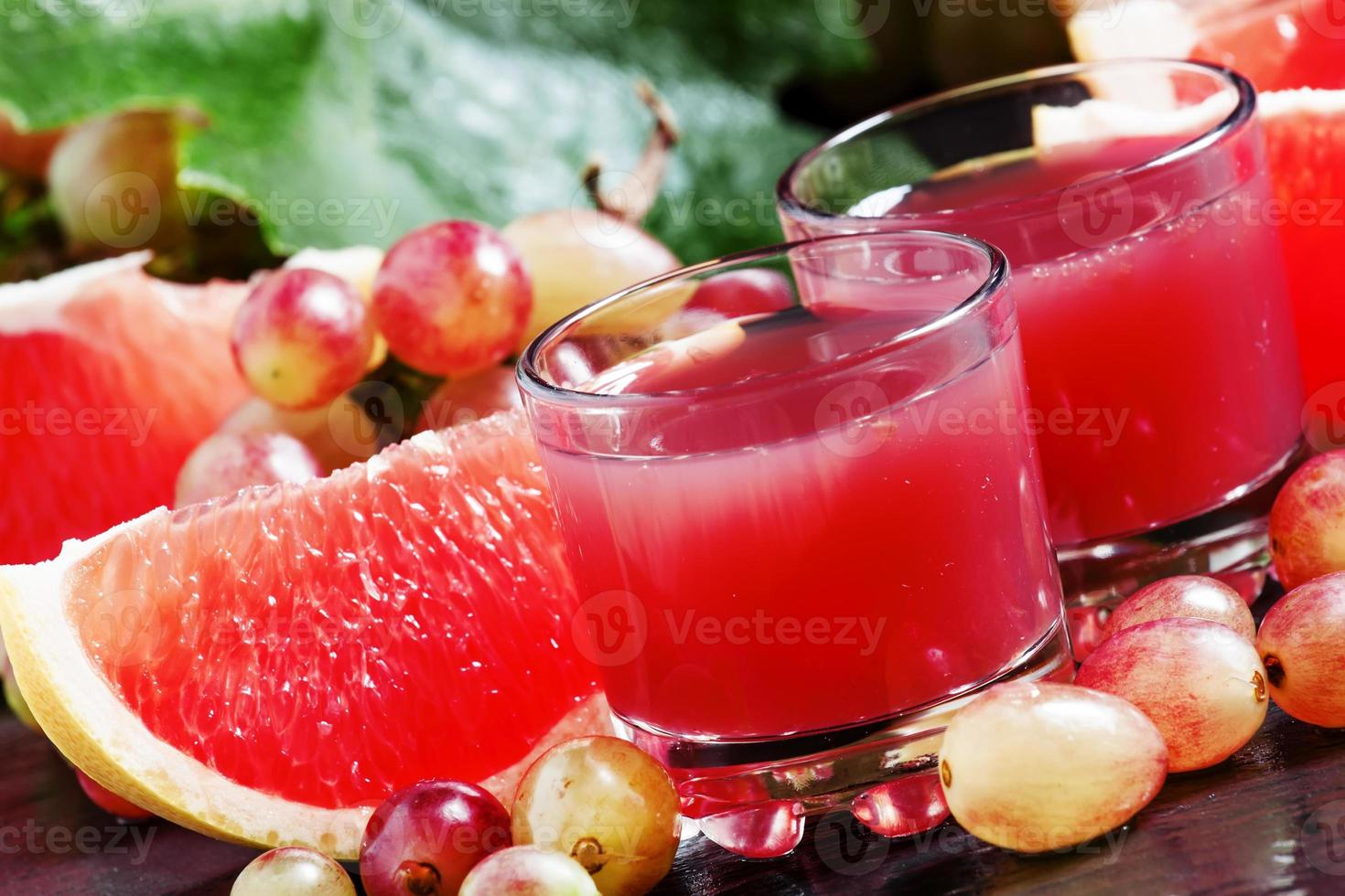 Fresh juice of red grapes and grapefruit photo