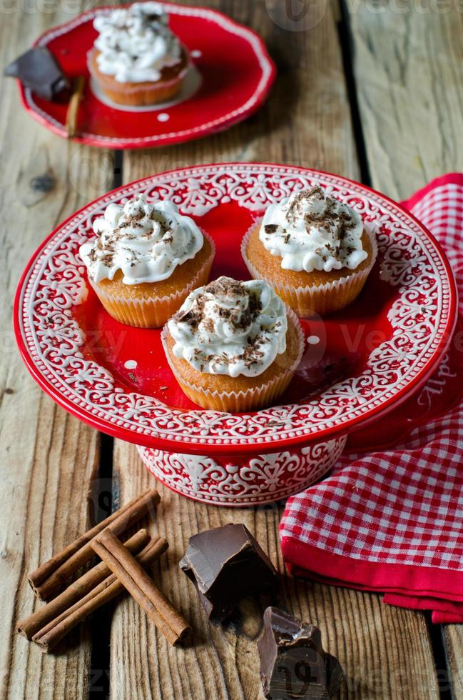 Cupcakes with whipped cream and chocolate photo