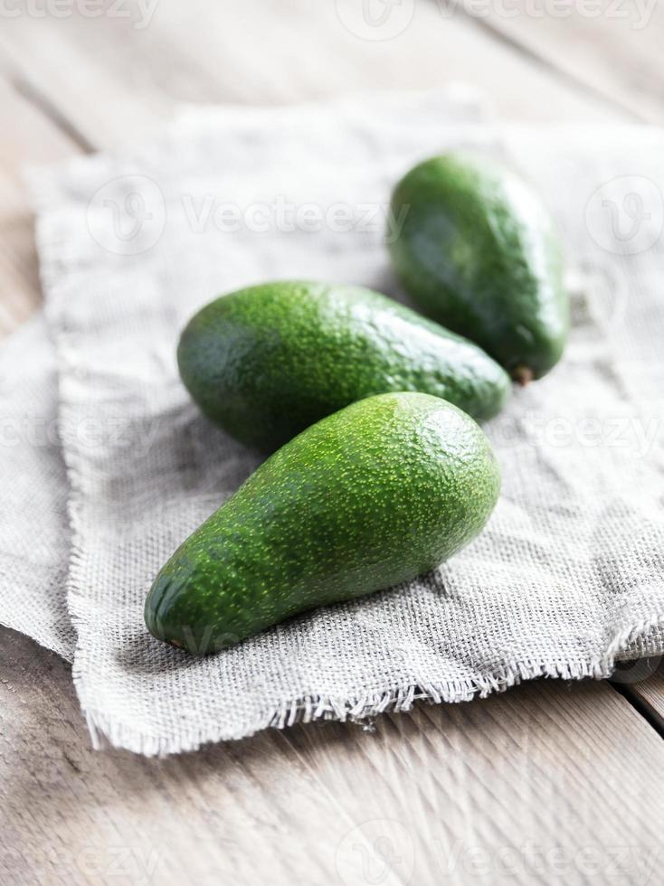 Avocado on the wooden table photo