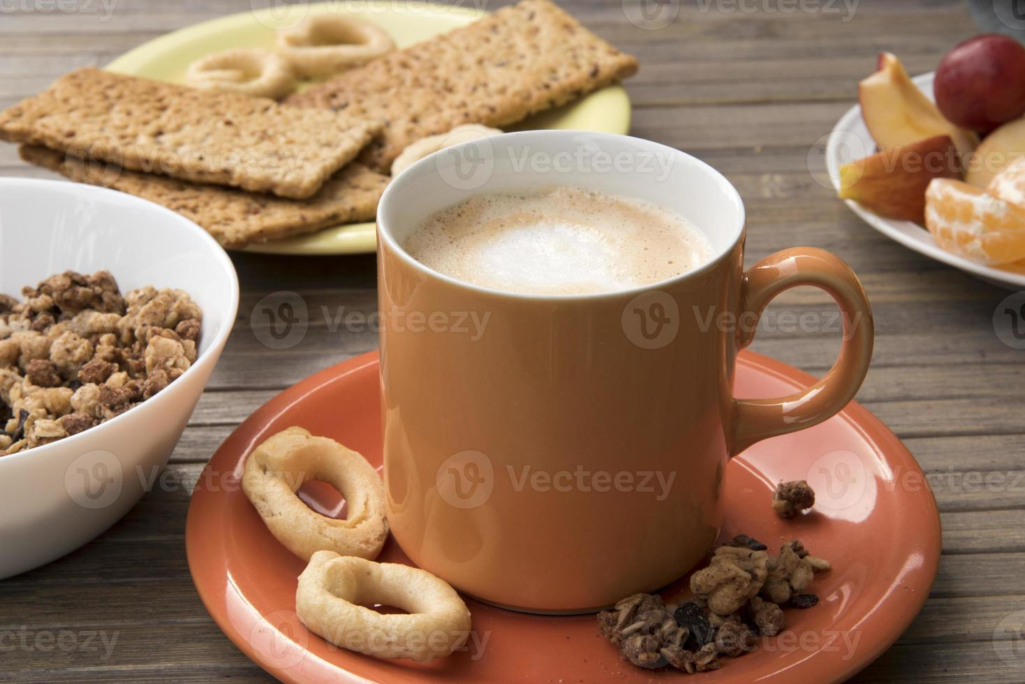 Cappuccino with pretzels and fruit photo
