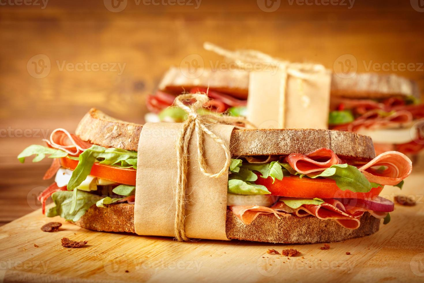 Sandwiches with bacon on vintage backgroud photo