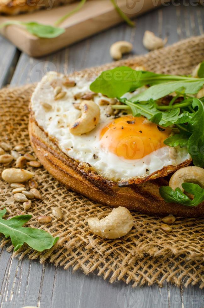 Village bread, fried eggs photo