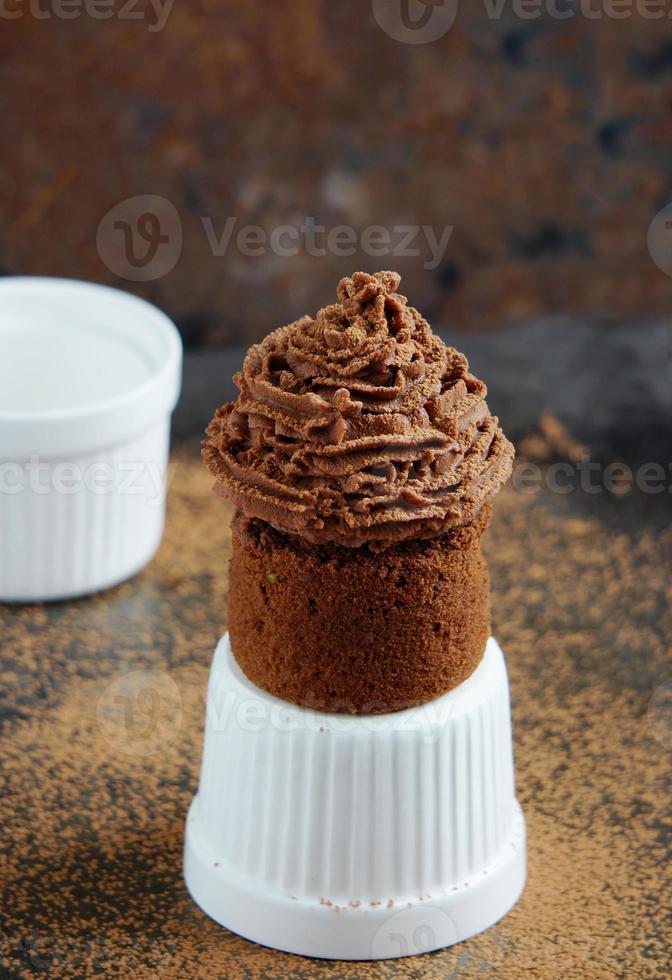 Chocolate cupcake with chocolate cream cheese cream photo