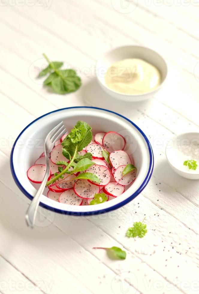 fresh salad with radish and poppy seeds photo
