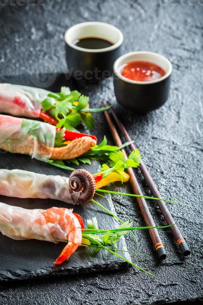Enjoy your spring rolls with vegetables and seafood photo