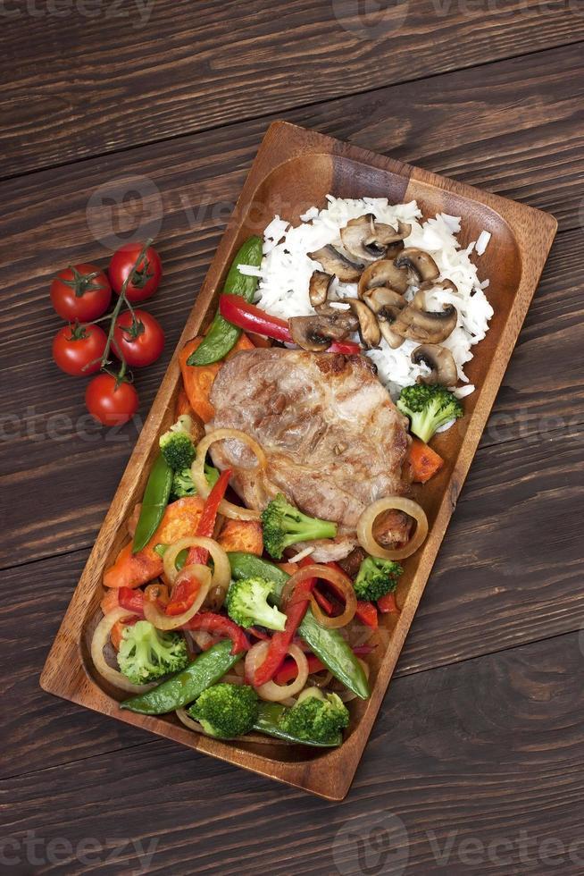 Pork  steak with garnish photo