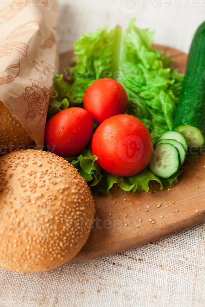 Hamburger ingredients on table photo