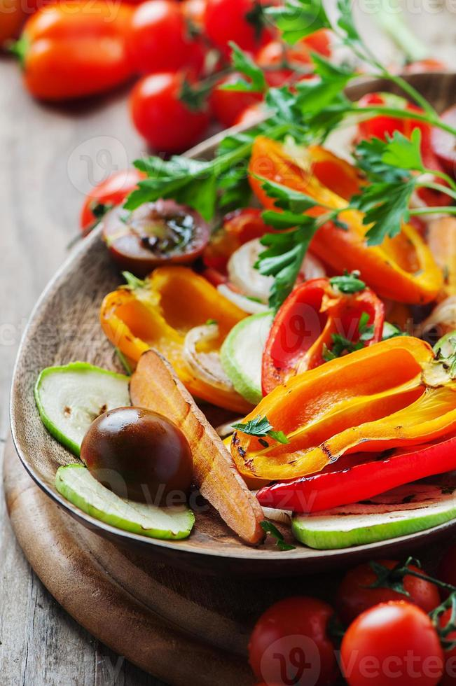 Grilled vegetables on the wooden table photo