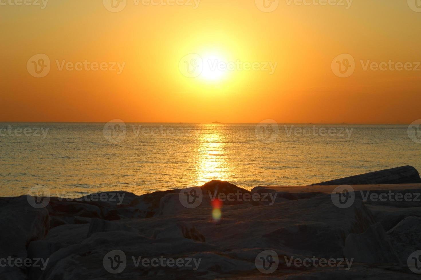 Sunset over water photo