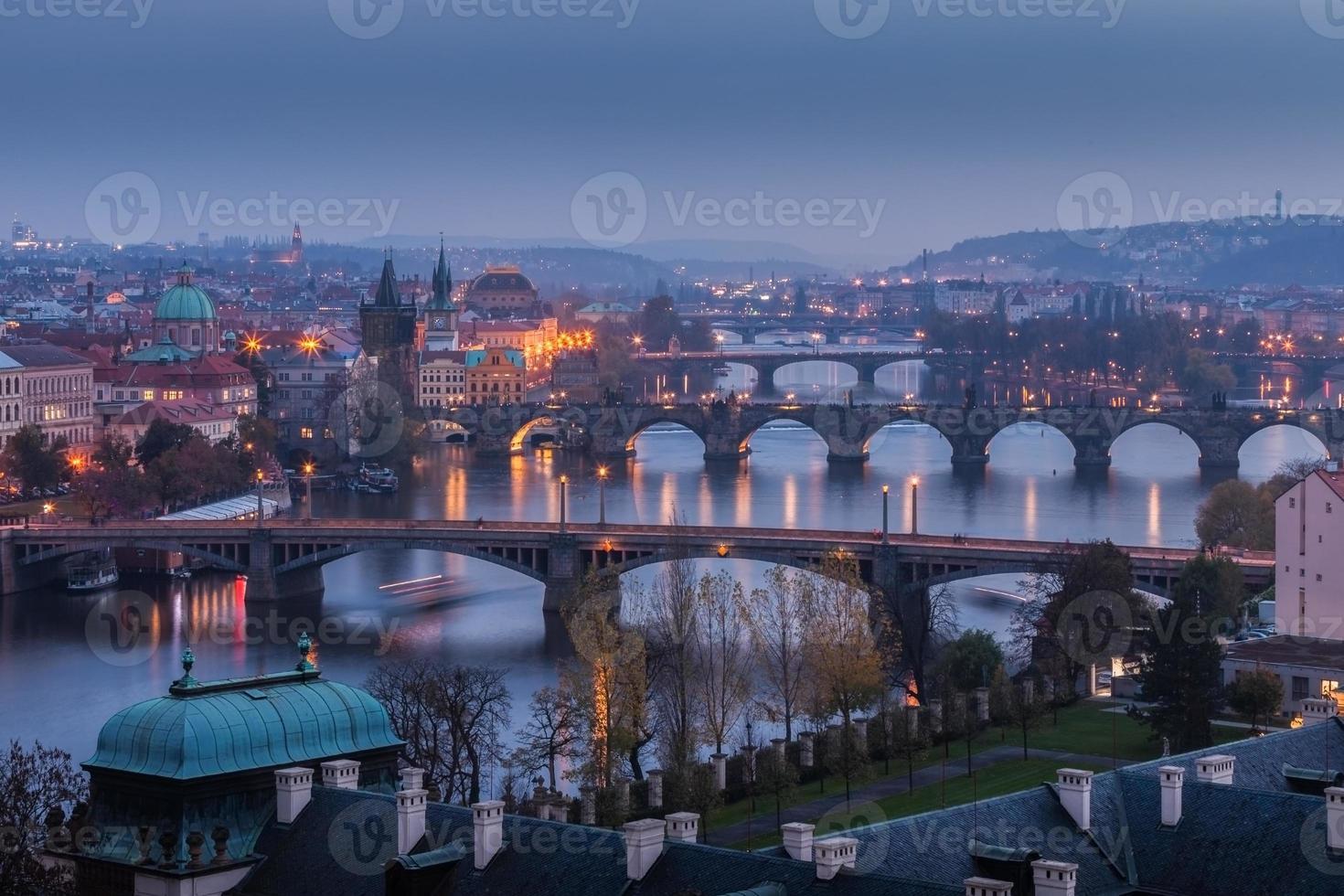 Prague bridges at sunset photo