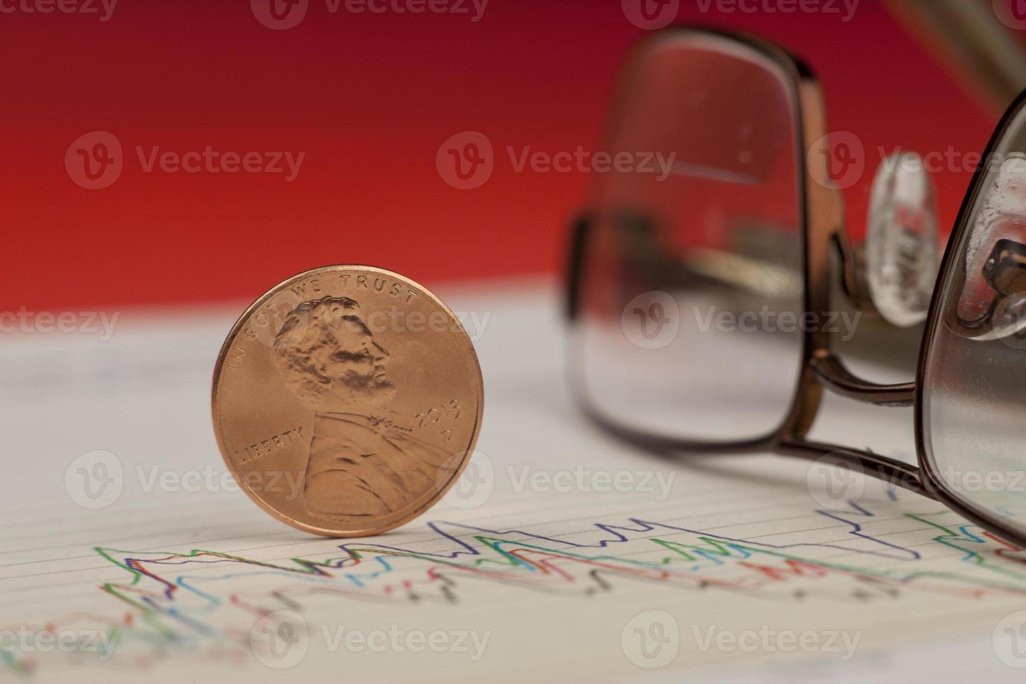 Closeup of penny on graph. photo