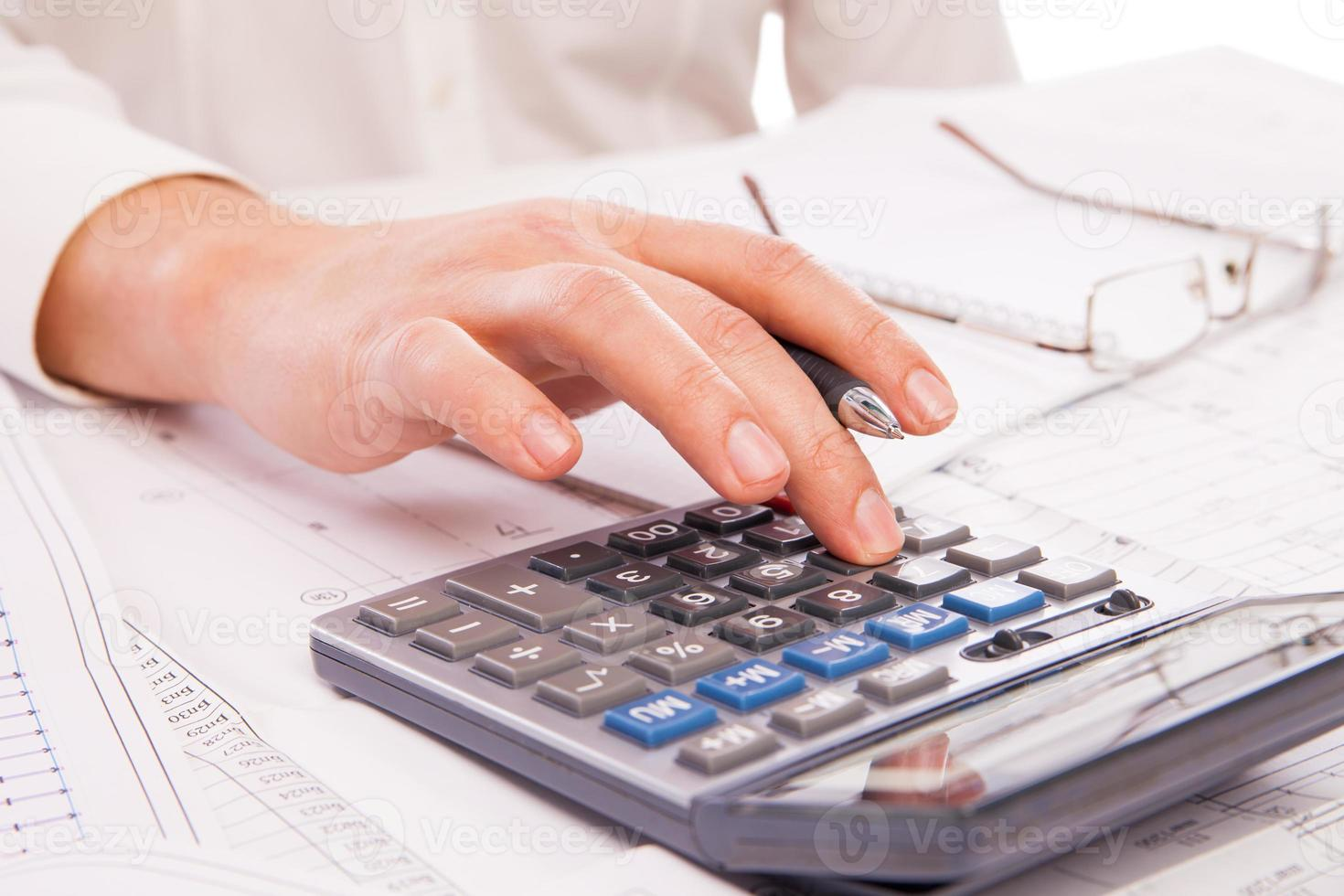 Hands of businessman with calculator photo