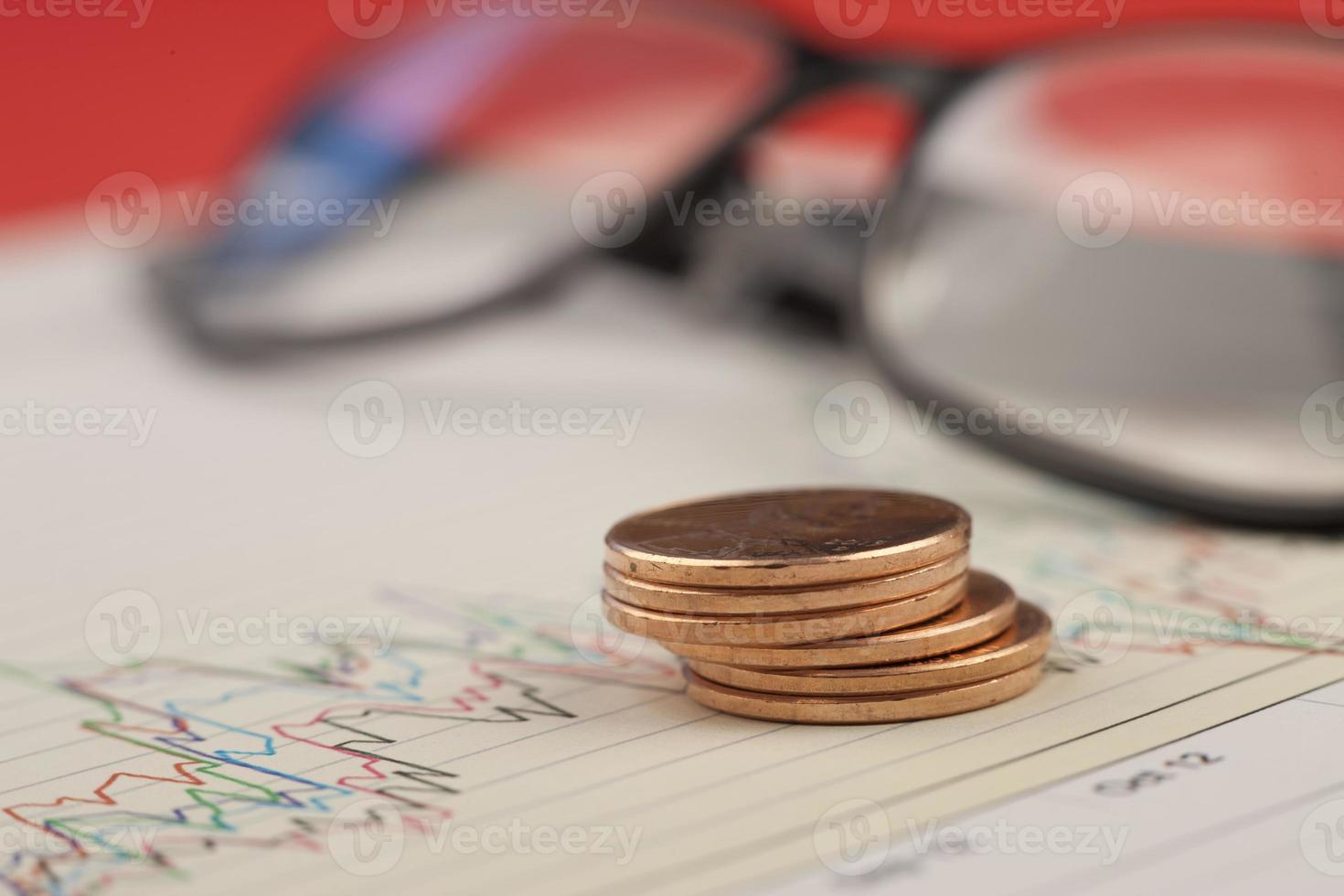 Pile of pennies on graph. photo