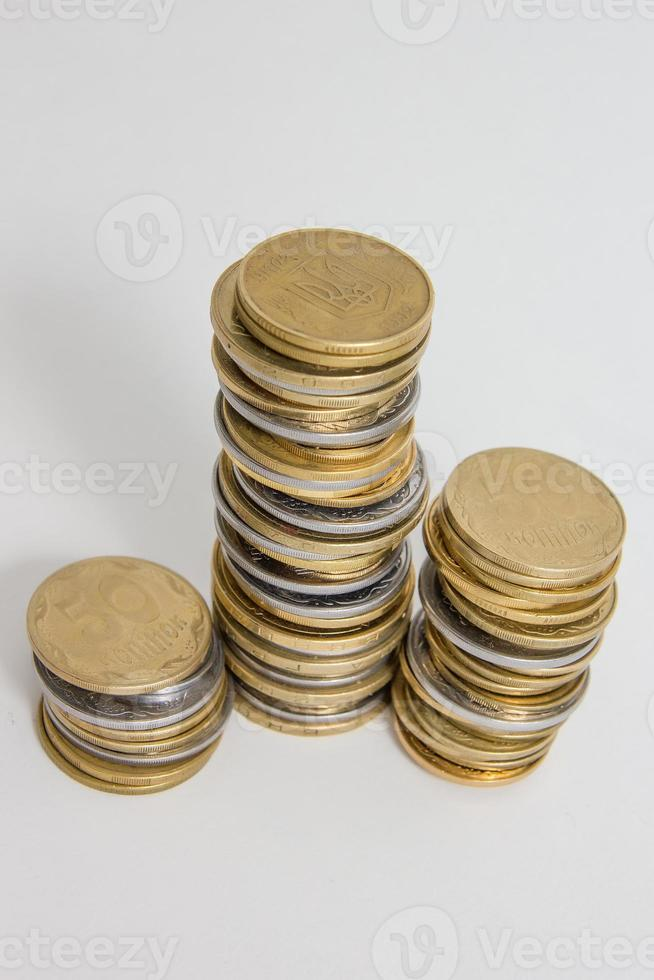 Columns of coins isolated on white background photo